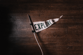 A flag with explore written on it