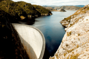 Water in a dam with hills rising on each side