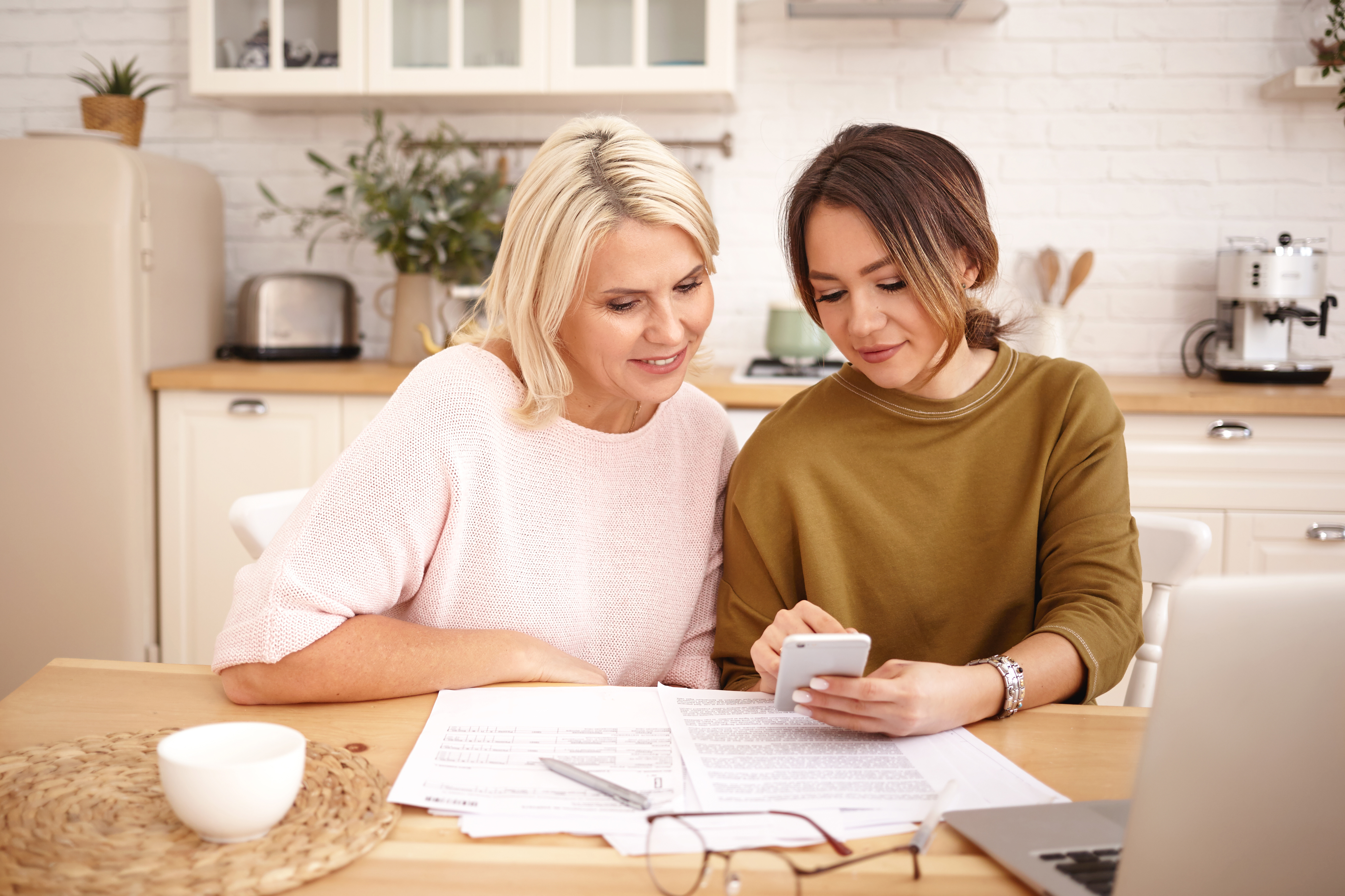 Parent and daughter looking at career options online