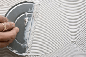 Man finishing a wall with plaster